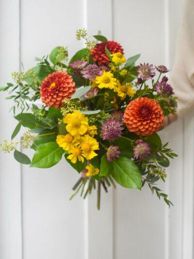 colorful autumn bouquet with orange dahlias