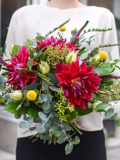large bouquet of seasonal flowers in autumn colors with large red dahlias